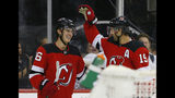 New Jersey Devils center Travis Zajac (19) congratulates center Jack Hughes (86) after scoring a goal against the Boston Bruins during the second period of an NHL preseason hockey game, Monday, Sept.16, 2019, in Newark,N.J. (AP Photo/Noah K. Murray)