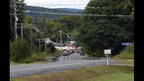 Emergency vehicles stand by, Monday, Sept. 16, 2019, at the scene of a deadly propane explosion which leveled new construction in Farmington, Maine. (Russ Dillingham/Sun Journal via AP)