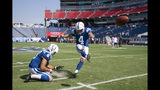 Indianapolis Colts kicker Adam Vinatieri (4) warms up with holder Rigoberto Sanchez (8) before an NFL football game against the Tennessee Titans Sunday, Sept. 15, 2019, in Nashville, Tenn. (AP Photo/James Kenney)