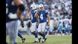 Indianapolis Colts kicker Adam Vinatieri (4) walks to the sideline with holder Rigoberto Sanchez after Vinatieri missed his second extra point of the game against the Tennessee Titans in the second half of an NFL football game Sunday, Sept. 15, 2019, in Nashville, Tenn. (AP Photo/Wade Payne)
