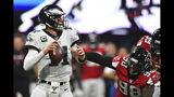 Philadelphia Eagles quarterback Carson Wentz (11) works in the pocket as Atlanta Falcons defensive end Takkarist McKinley (98) defends during the first half of an NFL football game, Sunday, Sept. 15, 2019, in Atlanta. (AP Photo/John Amis)