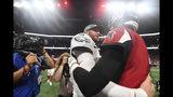 Philadelphia Eagles quarterback Carson Wentz (11) speaks with Atlanta Falcons quarterback Matt Ryan (2) after an NFL football game, Sunday, Sept. 15, 2019, in Atlanta. The Atlanta Falcons won 24-20. (AP Photo/John Amis)
