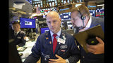 Mario Picone, center, and Michael Milano, right, work at the New York Stock Exchange, Monday, Sept. 16, 2019. Global stock markets sank Monday after crude prices surged following an attack on Saudi Arabia's biggest oil processing facility. (AP Photo/Mark Lennihan)