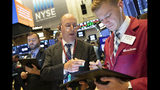 Gordon Charlop, center, and Christian Bader work at the New York Stock Exchange, Monday, Sept. 16, 2019. Global stock markets sank Monday after crude prices surged following an attack on Saudi Arabia's biggest oil processing facility. (AP Photo/Mark Lennihan)