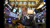 Trader Gregory Rowe monitors stock prices at the New York Stock Exchange, Monday, Sept. 16, 2019. Global stock markets sank Monday after crude prices surged following an attack on Saudi Arabia's biggest oil processing facility. (AP Photo/Mark Lennihan)