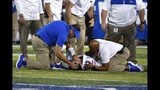 Florida coach Dan Mullen consoles quarterback Feleipe Franks (13) as he lies injured on the field during the second half of the team's NCAA college football game in Lexington, Ky., Saturday, Sept. 14, 2019. Florida won 29-21. (AP Photo/Timothy D. Easley)
