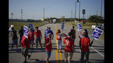 Striking plant workers block the passage of two trucks outside the General Motor assembly plant in Bowling Green, Ky, Monday, Sept. 16, 2019. More than 49,000 members of the United Auto Workers walked off General Motors factory floors or set up picket lines early Monday as contract talks with the company deteriorated into a strike. (AP Photo/Bryan Woolston)