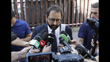 Massimo Ferrandino, lawyer of the widow of police officer Mario Cerciello Rega speaks to reporters outside Rome's courthouse, Monday, Sept. 16, 2019. The lawyers for one of two American teenagers being held in the July slaying of the police officer have dropped a request for their client Gabriel Natale-Hjorth to be released, saying they need more time to study new evidence emerged from the investigation. (AP Photo/Gregorio Borgia)