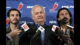 FILE - In this Sept. 12, 2012, file photo, National Hockey League Players' Association executive director Donald Fehr, center, is joined by players George Parros , left, and Kevin Westgath after meeting with NHL officials in New York. The NHLPA announces its decision whether to terminate the current collective bargaining agreement and set the clock ticking toward another potential work stoppage in 2020. (AP Photo/Mary Altaffer, File)