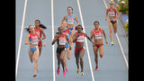 FILE _ In this Aug. 18, 2013, file photo, from front left to right, Russia's Mariya Savinova, Kenya's Eunice Jepkoech Sum, United States' Alysia Johnson Montano and United States' Brenda Martinez compete in the women's 800-meter final at the World Athletics Championships in the Luzhniki stadium in Moscow, Russia. Montano will receive bronze medals she was cheated out of by Savinova who finished ahead of her at the 2011 and 2013 world championships but was later disqualified for doping. (AP Photo/Martin Meissner, File)