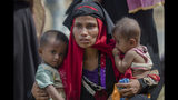 FILE - In this Oct. 22, 2017, file photo, Rohingya Muslim woman, Rukaya Begum, who crossed over from Myanmar into Bangladesh, holds her son Mahbubur Rehman, left and her daughter Rehana Bibi, after the government moved them to newly allocated refugee camp areas, near Kutupalong, Bangladesh. A special U.N. body has wrapped up two years of documenting alleged human rights violations by Myanmar's security forces with a call for the Southeast Asian nation be held responsible in international legal forums for genocide against the Muslim Rohingya minority. (AP Photo/Dar Yasin, File)