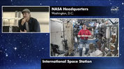 """In this image taken from NASA video actor Brad Pitt, left, star of the new space movie """"Ad Astra,"""" speaks from NASA headquarters in Washington, to astronaut Nick Hague abroad the International Space Station, on Monday, Sept. 16, 2019. (NASA via AP)"""