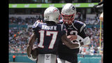 New England Patriots quarterback Tom Brady (12) wide receiver Antonio Brown (17) after Brown scored a touchdown, during the first half at an NFL football game against the Miami Dolphins, Sunday, Sept. 15, 2019, in Miami Gardens, Fla. (AP Photo/Lynne Sladky)