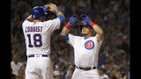 Chicago Cubs' Kyle Schwarber, right, celebrates his three-run home run off Cincinnati Reds starting pitcher Kevin Gausman with Ben Zobrist during the first inning of a baseball game Monday, Sept. 16, 2019, in Chicago. Kris Bryant also scored the play. (AP Photo/Charles Rex Arbogast)