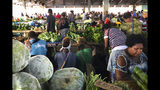 In this Nov. 24, 2018, photo, customers shop for vegetables at the Honiara Central Market in Honiara, the capital of the Solomon Islands. The Solomon Islands switched diplomatic recognition from Taiwan to China on Monday, Sept. 16, 2019, becoming the latest country to leave the dwindling Taiwanese camp.(AP Photo/Mark Schiefelbein)