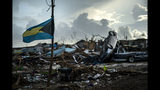 A Bahamas flag flies tied to a sapling, amidst the rubble left by Hurricane Dorian in Abaco, Bahamas, Monday, Sept. 16, 2019. Dorian hit the northern Bahamas on Sept. 1, with sustained winds of 185 mph (295 kph), unleashing flooding that reached up to 25 feet (8 meters) in some areas. (AP Photo/Ramon Espinosa)