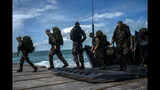 German soldiers disembark at the port to assist in the reconstruction in the aftermath of Hurricane Dorian in Abaco, Bahamas, Monday, Sept. 16, 2019. Dorian hit the northern Bahamas on Sept. 1, with sustained winds of 185 mph (295 kph), unleashing flooding that reached up to 25 feet (8 meters) in some areas. (AP Photo/Ramon Espinosa)