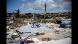 An abandoned bicycle stands in a space that used to be a house, in a neighborhood destroyed by Hurricane Dorian, in Abaco, Bahamas, Tuesday, Sept. 17, 2019. Dorian hit the northern Bahamas on Sept. 1, with sustained winds of 185 mph (295 kph), unleashing flooding that reached up to 25 feet (8 meters) in some areas. (AP Photo/Ramon Espinosa)