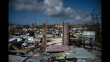 The rubble of a destroyed neighborhood stands in the aftermath of Hurricane Dorian in Abaco, Bahamas, Tuesday, Sept. 17, 2019. Dorian hit the northern Bahamas on Sept. 1, with sustained winds of 185 mph (295 kph), unleashing flooding that reached up to 25 feet (8 meters) in some areas. (AP Photo/Ramon Espinosa)