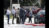 Maine Gov. Janet Mills , right, speaks to officials at the scene of an explosion Monday, Sept. 16, 209, in Farmington, Maine. Officials say a town's fire chief is among the injured in a propane explosion that killed a firefighter. State public safety spokesman Steve McCausland said after Monday morning's explosion at a nonprofit center in Farmington that multiple people remain hospitalized. (AP Photo/Robert F. Bukaty)