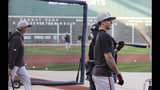 San Francisco Giants right fielder Mike Yastrzemski, right, loosens up during batting practice prior to a baseball game against the Boston Red Sox at Fenway Park in Boston, Tuesday, Sept. 17, 2019. Yastrzemski is the grandson of Red Sox great and Hall of Famer Carl Yastrzemski. (AP Photo/Charles Krupa)