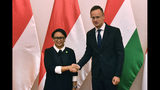 Hungarian Minister of Foreign Affairs and Trade Peter Szijjarto, right, receives Indonesian Foreign Minister Retno Marsudi in the Ministry of Foreign Affairs and Trade in Budapest, Hungary, Tuesday, September 17, 2019. (Zoltan Mathe/MTI via AP)