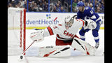 Carolina Hurricanes goaltender Anton Forsberg (31) makes a save on a shot as Tampa Bay Lightning right wing Taylor Raddysh (16) looks for a rebound during the second period of an NHL preseason hockey game Tuesday, Sept. 17, 2019, in Tampa, Fla. (AP Photo/Chris O'Meara)