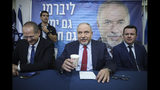 FILE - In this May 30, 2019 file photo, former Israeli Defense Minister and Yisrael Beiteinu party leader Avigdor Lieberman speaks at a press conference in Tel Aviv, Israel. Netanyahu's nemesis, Lieberman, holds considerable power after his party thwarted the formation of a Likud-led government in April. Once again, he is the kingmaker. (AP Photo/Oded Balilty, File)