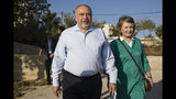 The leader of the Yisrael Beiteinu (Israel Our Home) right-wing nationalist party Avigdor Liberman come to vote with is wife Ella in the settlement of Nokdim, West Bank, Tuesday, Sept. 17, 2019. (AP Photo/Tsafrir Abayov)