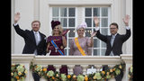 Dutch King Willem-Alexander, Queen Maxima, Princess Laurentien and Prince Constantijn, from left to right, wave from the balcony of royal palace Noordeinde in The Hague, Netherlands, Tuesday, Sept. 17, 2019, after a ceremony marking the opening of the parliamentary year with a speech by King Willem-Alexander outlining the government's budget plans for the year ahead. (AP Photo/Peter Dejong)