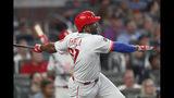 Philadelphia Phillies' Jose Pirela follows through on a three-run home run during the fourth inning of the team's baseball game against the Atlanta Braves on Tuesday, Sept. 17, 2019, in Atlanta. (AP Photo/John Bazemore)