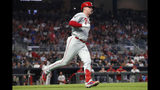 Philadelphia Phillies' Rhys Hoskins runs to first base after hitting a two-run home run during the fourth inning of the team's baseball game against the Atlanta Braves on Tuesday, Sept. 17, 2019, in Atlanta. (AP Photo/John Bazemore)