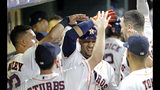 Houston Astros' Yuli Gurriel is congratulated in the dugout after hitting a home run against the Texas Rangers during the fifth inning of a baseball game Tuesday, Sept. 17, 2019, in Houston. (AP Photo/David J. Phillip)