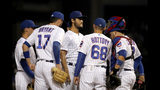 Chicago Cubs starting pitcher Yu Darvish, center, gets a visit from pitching coach Tommy Hottovy (68) during the first inning of a baseball game against the Cincinnati Reds Tuesday, Sept. 17, 2019, in Chicago. (AP Photo/Charles Rex Arbogast)