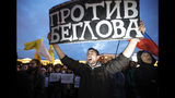 An activist holds a poster reading 'Against Beglov' during a meeting against the violations during governor and municipal elections in St.Petersburg, Russia, Tuesday, Sept. 17, 2019. Alexander Beglov is newly elected St. Petersburg's governor pro-Kremlin candidate. (AP Photo/Dmitri Lovetsky)