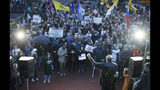 People gather for a meeting against the violations during governor and municipal elections in St.Petersburg, Russia, Tuesday, Sept. 17, 2019. (AP Photo/Dmitri Lovetsky)
