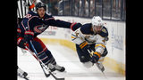 Buffalo Sabres defenseman Brandon Hickey, right, trips in front of Columbus Blue Jackets forward Sonny Milano during the third period of an NHL preseason hockey game in Columbus, Ohio, Tuesday, Sept. 17, 2019. The Blue Jackets won 4-1. (AP Photo/Paul Vernon)