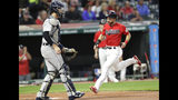 Cleveland Indians' Mike Freeman scores on a double by Roberto Perez during the second inning in the team's baseball game against the Detroit Tigers, Tuesday, Sept. 17, 2019, in Cleveland. Tigers catcher Grayson Greiner is at left. (AP Photo/Tony Dejak)