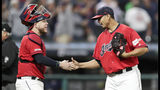 Cleveland Indians relief pitcher Carlos Carrasco, right, is congratulated by catcher Roberto Perez after the Indians defeated the Detroit Tigers 7-2 in a baseball game Tuesday, Sept. 17, 2019, in Cleveland. (AP Photo/Tony Dejak)