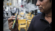 Inam Rehman, manager of Jubilee Vape & Smoke Inc., vapes while discussing New York Gov. Andrew Cuomo's push to enact a statewide ban on the sale of flavored e-cigarettes amid growing health concerns, Monday Sept. 16, 2019, in New York. (AP Photo/Bebeto Matthews)