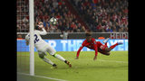 Bayern's Kingsley Coman, right, scores his side's opening goal during the Champions League group B first round soccer match between FC Bayern Munich and Red Star Belgrade, in Munich, Germany, Wednesday, Sept. 18, 2019. (AP Photo/Matthias Schrader)