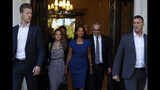 Anti-Brexit campaigner Gina Miller, centre, leaves The Supreme Court flanked by security, in London, Tuesday, Sept. 17, 2019. The Supreme Court is set to decide whether Prime Minister Boris Johnson broke the law when he suspended Parliament on Sept. 9, sending lawmakers home until Oct. 14 - just over two weeks before the U.K. is due to leave the European Union.(AP Photo/Alastair Grant)