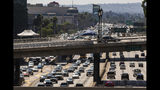 """Los Angeles Police officers patrol the ramps over the traffic on the Harbor Freeway for the visit of President Donald Trump in Los Angeles Tuesday, Sept. 17, 2019. Trump began a California visit on Tuesday, saying he will do """"something"""" about homelessness but offering no specifics beyond the mention of creating a task force. (AP Photo/Damian Dovarganes)"""