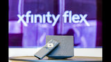 In this Monday, Sept. 16, 2019 photo, an Xfinity Flex device is displayed in Philadelphia. As big entertainment companies prepare to launch their new streaming services, Comcast is trying to bolster Flex, its Roku-like streaming bundle, by dropping its $5 fee. Comcast said Wednesday, Sept. 18, 2019, that one box would now be free for its home internet customers. Additional boxes would still cost $5 each. (Eric Kayne/Comast via AP Images)