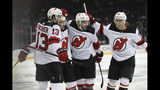 New Jersey Devils center Nico Hischier (13) celebrates with teammates after his goal during the first period against the New York Rangers in a preseason NHL hockey game Wednesday, Sept. 18, 2019, at Madison Square Garden in New York. (AP Photo/Mary Altaffer)