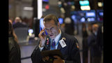 Stock trader Gregory Rowe works at the New York Stock Exchange, Wednesday, Sept. 18, 2019. The Federal Reserve is expected to announce its benchmark interest rate later in the day. (AP Photo/Mark Lennihan)