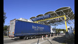 """A truck on its way to France waits to be checked by employees of Eurotunnel during a day of test in case of no deal Brexit at the entrance of the Channel tunnel in Folkestone, Tuesday, Sept. 17, 2019. British Prime Minister Boris Johnson has said after a meeting with European Commission President Jean-Claude Juncker that """"there is a good chance"""" of a Brexit deal with the European Union. (Denis Charlet, Pool via AP)"""