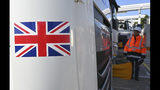 """An employee of Eurotunnel checks a British truck on its way to France during a day of test in case of no deal Brexit at the entrance of the Channel tunnel in Folkestone, Tuesday, Sept. 17, 2019. British Prime Minister Boris Johnson has said after a meeting with European Commission President Jean-Claude Juncker that """"there is a good chance"""" of a Brexit deal with the European Union. (Denis Charlet, Pool via AP)"""