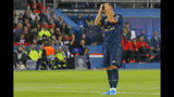 Real Madrid's Eden Hazard reacts after failing to score during the Champions League group A soccer match between PSG and Real Madrid at the Parc des Princes stadium in Paris, Wednesday, Sept. 18, 2019. (AP Photo/Michel Euler)
