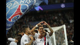 PSG's Angel Di Maria, right, celebrates after scoring his side's second goal during the Champions League group A soccer match between PSG and Real Madrid at the Parc des Princes stadium in Paris, Wednesday, Sept. 18, 2019. (AP Photo/Francois Mori)